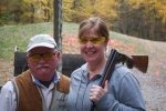 Posing at the shooting range with my patient instructor - I hit one