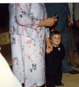 My favorite picture of all time at Becca's baptism. My mom with Dan (and his red sneakers)